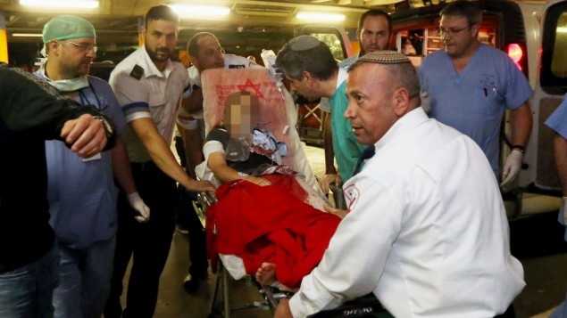 A 9-year-old girl, who was shot Saturday night in the settlement of Psagot, is brought to Shaare Zedek Medical Center in Jerusalem. (photo credit: Flash90)